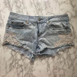 Cut off denim American eagle shorts with lace